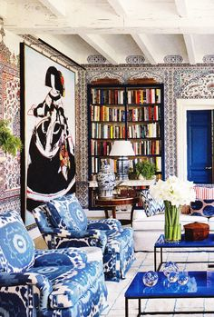 Living room with moorish tiles on the walls by Miles Redd.