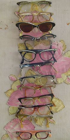 glasses collection--- Loving the 3rd pair down from the top!!