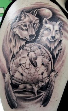 Wolves and dream catcher tattoo by DeadlyInk, via Flickr