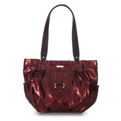 Ceceila    Do you ever wake up feeling absolutely ready to take on the world? Show it by wearing the Ceceila Shell for Demi Bags on your arm! Bold, glossy cerise-red patent faux leather is ultra-sexy and ready for anything you have planned today. Chic front buckle accent and deep side-pockets add even more flair to this stand-out in the Miche Demi Bag collection!    Base bag not included.