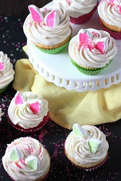 Vanilla bean Easter Bunny Cupcakes with a hint of citrus, piled high with a deliciously sweet frosting and topped with cute marshmallow rabbit ears (that sort of resemble kitten ears). These cupcakes are not only a fun kiddie activity, but a tasty one too!