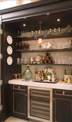Fully-equipped bar inside of this custom cabinet designed by Jack Arnold Companies.