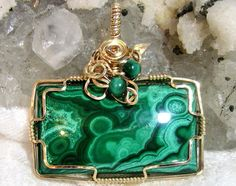 Hey, I found this really awesome Etsy listing at https://www.etsy.com/il-en/listing/220423532/large-malachite-pendant-east-west-wire