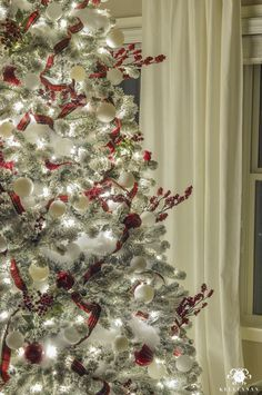 Red and White Woodland Christmas tree with red berries, applies, and red birds at Night in the bedroom