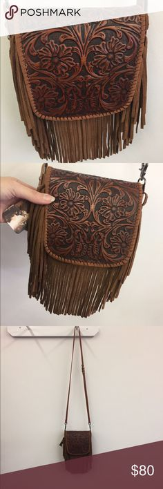 """Leather purse Buttery soft leather purse! Has clips so you can also wear as waist bag! Made of 100% genuine leather this crossbody has: Basketweave and vintage tooled leather with matching color inlay. Leather fringe (4"""" ). Flap with magnetic closure. Inside of crossbody have a single compartment. A zippered pocket on the back. A detachable shoulder leather strap included (44""""). 8"""" X 1"""" 7.5 (Strap 44"""") Bags"""