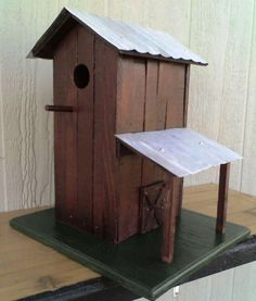 South Carolina style Tobacco Barn Birdhouse built using 70-100 year old Tobacco Sticks. Painted darkened Red with metal roofs... $70.00, via Etsy.