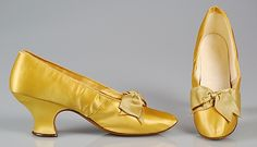Yellow silk satin evening slippers with ribbon bows, by J. Ferry, French, 1890-99.