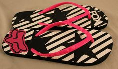 Fox Racing black, white & pink flip flop sandals. Black & white striped sole with pink straps.