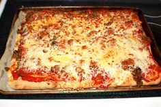 What's Cookin' Italian Style Cuisine: Italian Sausage Mushroom and Pepper Pizza Recipe Video