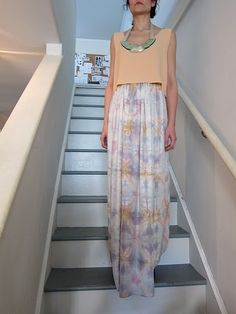 Pastel maxi skirt and crop top with statement necklace. I would love this in a different colour, like green, brown and gold