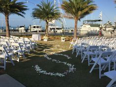 Wedding Ceremony with spiral Floral Display #Flwers #IDO #Wedding #Ceremony #SpecialEvent #Beautiful #Marina #Yacht Club #EventLawn #Waterfront #PalmTrees #Florida #TheKeys #Destination