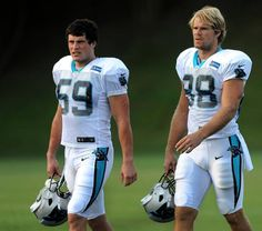 Carolina Panthers linebacker Luke Kuechly, left, and tight end Greg Olsen right, walk to the practice fields on Thursday, August 20, 2015. The Panthers hosted the Miami Dolphins in a joint practice at Wofford College in Spartanburg, SC.