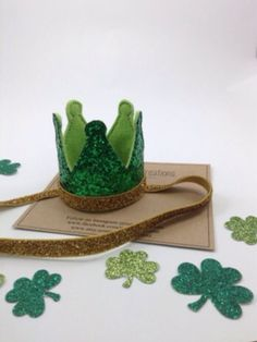 Show off your Green with this Glitter Crown Headband!    A green glitter crown headband sewn with an embroidery machine with lime felt backing and