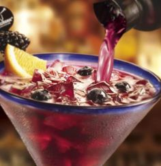 Longhorn Steakhouse Black and Blue Margarita....Loved it!  We start by muddling fresh blueberries and blackberries then adding 100percent Blue Agave 1800 Tequila, and all-natural lemon and lime juices