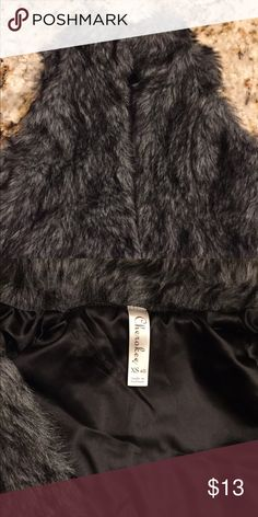Girls Fur Vest Girls Cherokee faux fur vest. Absolutely adorable with leggings!! Has 2 clasps in front to secure. EUC Cherokee Jackets & Coats Vests