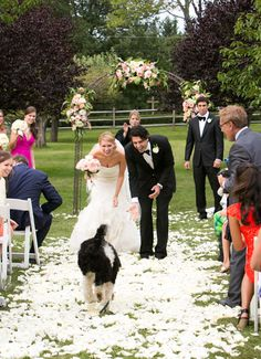 The groom called the dog before they processed out and they walked out as a family!❤