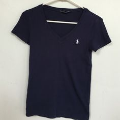 Ralph Lauren polo v neck Navy blue color. Size small. No holes or stains etc. good condition! Ralph Lauren Tops Tees - Short Sleeve
