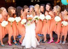Short orange bridesmaid dresses with colorful shoes | Courtney Dox Photography