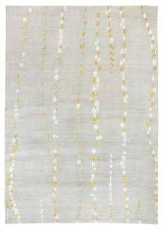 "WATERFALL PALE Allegra Hicks ""This rug is a watercolour; the way it has been created reflects the feeling of a watercolour and its fragility. It is inspired by drops of water on weeping willows"". Allegra Hicks The background is a pale blue grey wool, with the motif in pale blue, white and olive green."