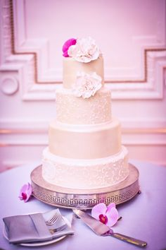 CAKE--ADD POPS OF COLOR WITH FLOWERS   Classic White Four Tier Wedding Cake