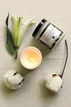 soft and lovely home fragrance from ACDC. Lilies & Linen candles combine the scents of stargazer lily blossoms, freshly laundered linen, teak wood and mandarin orange in an apothecary jar with soy wax