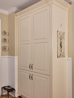 Small Closet Makeovers Design: I like the antique ivory or distressed look on woodwork, but especially the Corinthian style molding on sides & top of cabinets.  Incorporate in closet makeover.  Should blend well with dark wood furniture and sage walls.