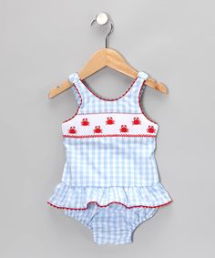 Here comes the sun, and this soft swimsuit will be ready to soak up some rays. Charming sea life is sweetly stitched on the front, while a ruffled skirt adds girly flair at the waist.55% cotton / 45% polyesterMachine wash; tumble dryMade in El Salvador