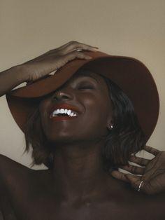 Black woman in camel hat