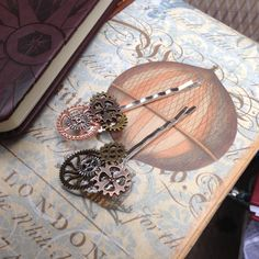 Cogs hair grips inspired by steampunk Victorian England mixed metal  alloy cogs on silver coloured filigree bobby pins. Wear just for fun by InspiredbySteamPunk on Etsy