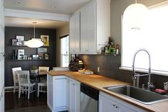 Paint colors that match this Apartment Therapy photo: SW 6172 Hardware, SW 6256 Serious Gray, SW 6991 Black Magic, SW 6003 Proper Gray, SW 7757 High Reflective White