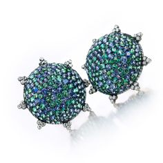 A Pair of Sapphire and Diamond Ear Clips, by JAR. Each designed pave-set green and violet sapphire dome, accented by single-cut diamonds, signed JAR.
