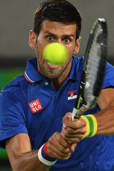 Serbia's Novak Djokovic returns the ball to Argentina's Juan Martin Del Potro during their men's first round singles tennis match at the Olympic...