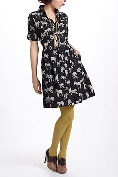 1920s-ish. Anthropologie shirt dress, oxford heels. I could live without the colored nylons, but otherwise very fun.