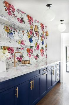 a bold home bar with floral wallpaper