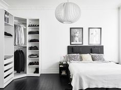 Black and white bedroom. ikea Pax wardrobe without doors.