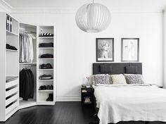 Open corner closet in bedroom