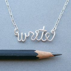"""""""Write"""" wire-wrapped necklace. http://www.etsy.com/listing/80390554/write-necklace-sterling-silver-wire-word"""
