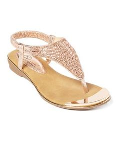 4004f36e7 Step into resort-ready style with this embellished sandal featuring an  ornate T-strap and a cushioned sole for a comfortable