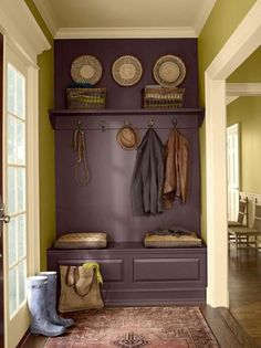 Purple and Green Mud Room...by painting the bench, a shelf and the wall behind it Purple, it looks like a built-in for way cheaper...