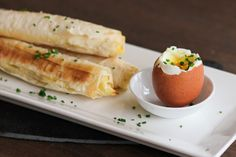 Truffled potato phyllo cigars dipped in a soft boiled egg. (recipe)