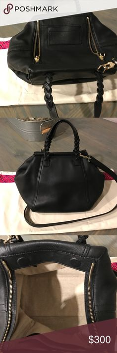 Tory Burch half moon satchel mini New with tag used for one week.. It is a beautiful bag very spacious!! leather is beautiful! Tory Burch Bags Satchels