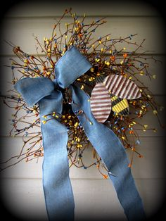 "Such a pretty wreath, Has a Wood and tin bumble bee....with pip berries in Blue, Yellow and Rust...This pip berry wreath measures 18"" comes with Bow and Tag .....Tag can read whatever you want........Just GORGEOUS ..... ready to ship....."
