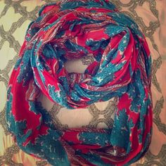 Lilly Pulitzer infinity scarf Lilly Pulitzer scarf! Tag is loose on one end. I have 6 to choose from, be sure to look at all of them! I'll give you a great bundle price for multiple  this listing is just for the blue and coral seashell infinity scarf happy shopping!!  Lilly Pulitzer Accessories Scarves & Wraps