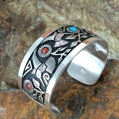 Highly detailed Sterling Silver Cuff Bracelet w/ Hummingbird design & Kingman Turquoise & Red Coral on oxidized etched background. By Navajo Artist Philbert Begay. Kingman Turquoise, Coral Turquoise, Turquoise Jewelry, Turquoise Bracelet, Silver Jewelry, Arrow Jewelry, Jewelry Art, Jewelry Ideas, Southwest Jewelry