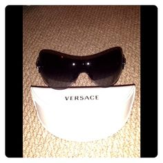 Authentic Versace Purple Shield Sunglasses Purple Shield Sunglasses. Never worn. There are dust particles on lenses in photo..those are not scratches. Price Reduced! Versace Accessories Sunglasses
