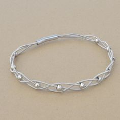 High Strung Studios - Braided Guitar String Bracelet with Shiny Silver Beads, $29.00 (http://www.highstrungstudios.com/braided-guitar-string-bracelet-with-shiny-silver-beads/)