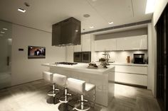 Interior Design, Black Cooker Hood White Stools With Back Laminate Floor Kitchen Island Oven Cabinet Dual Fuel Ranges Mounted Wall Led Tv 50 Inch Glass Door And Ceiling Exhaust Fan Kitchen ~ Splendid Contemporary Interior with Natural Element to Accent