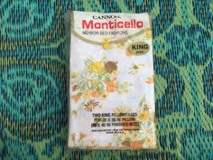 Vintage 1960s Cannon Monticello No-Iron Bed Fashions. Orange, yellow brown, daisy bouquets. Floral on white background.