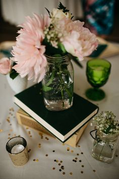 Gorgeous bookworm-inspired table centerpiece. View the full wedding here: http://thedailywedding.com/2016/05/13/classy-woods-wedding-tiffany-dustin/