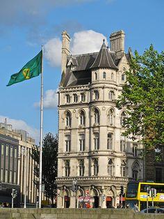 The Irish Harp flag flies outside this elegant building in Dublin